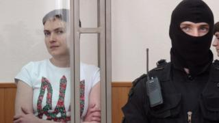 Ukrainian military pilot Nadiya Savchenko (left) inside a cage during her trial in Donetsk, southern Russia. Photo: 21 March 2016