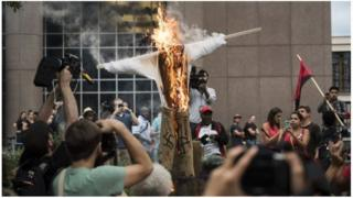 EFFDIGY OF PRESIDENT DONALD TRUMP BURNED AS A PROTEST AGAINST HATE CRIMES