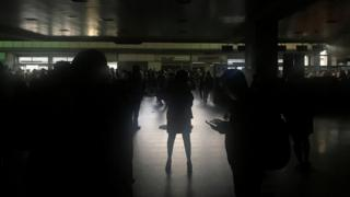 Passengers are seen during a blackout at Simon Bolivar international airport in Caracas, Venezuela March 25, 20