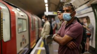 Commuters wearing face masks on Tube