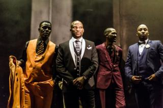 Traditional Isicathamiya competitors prepare backstage to display their sense of style and fashion in the funky category known as 'Oswenka' (Swank), at the Natal Playhouse Theatre in Durban on September 23, 2018, during an Isicathamiya competition. - The National Isicathamiya Competition held annually includes over 150 groups competing in the Isicathamiya style, an a capella choral singing style developed in South Africa by migrant Zulu communities.