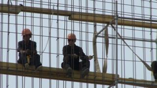 Trabalhadores norte-coreanos em obra na Polônia