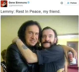 Kiss frontman Gene Simmons hugging Lemmy