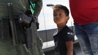 A migrant child from Honduras is detained by US border patrol