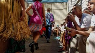 "Models present crochet clothing creations made by inmates as part of ""Ponto Firme"" project in the Adriano Marrey maximum security penitentiary in Guarulhos, Brazil on May 22, 2019."