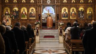 "Worshippers attend Christmas Morning mass at a Syriac Orthodox Church in Syria""s northern city of Aleppo"