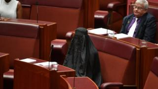 Pauline Hanson sits in Austalia's Senate wearing a burka