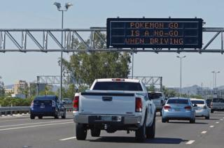 Arizona Dept. of Transportation freeway sign along westbound Interstate 10 discourages playing Pokemon Go