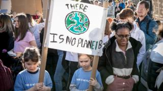 Kids protest with a banner saying there is no planet b