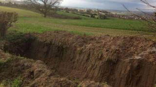 Trench dug at edge of field
