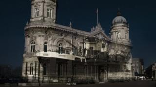 Projection on to Hull Maritime Museum of a boat