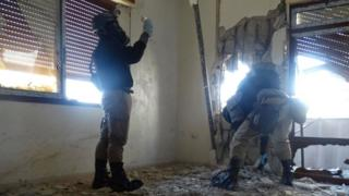UN chemical weapons experts investigate the site of an alleged chemical weapons attack in Damascus, 2013