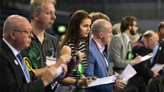 Party officials at Glasgow count