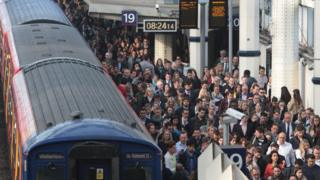 File photo of commuters waiting to pass through the barriers at Waterloo station during the tube strike