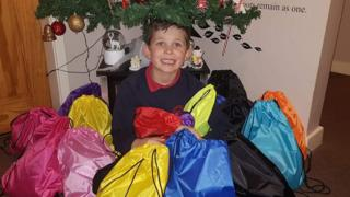 Mason with bags for homeless collection