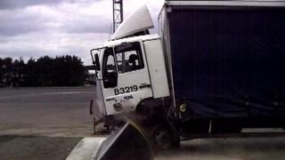 A truck smashing into a truck barrier ramp