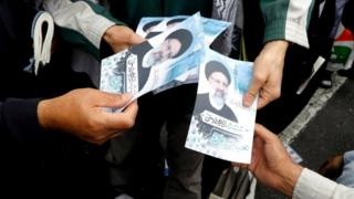 Flyers are handed out for candidate Ebrahim Raisi in Tehran