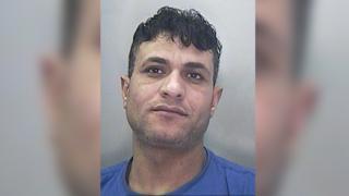 A police mug shot of Mohamed Amin