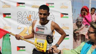 Salah Ameidan holding the Saharawi flag