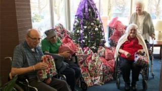 Residents at The Pines nursing home in Glen Falls receive their Christmas gift bags