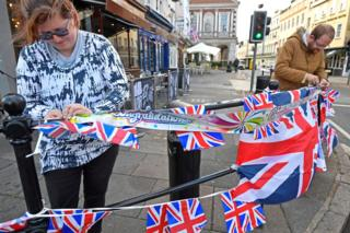 People string up bunting, on the day before the royal wedding of Britain's Princess Eugenie and Jack Brooksbank, in Windsor, Britain, October 11, 2018
