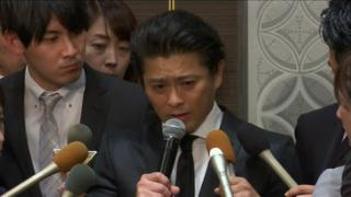 Tatsuya Yamaguchi speaks into a microphone at a press conference in Japan