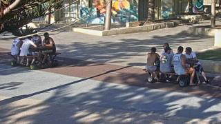 CCTV images of men riding motorised picnic tables in Perth