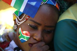 "South African sporting fans react with disappointment following the announcement of the winning candidate to host the 2023 Rugby World Cup at a public viewing area in Sammy Marks Square, Pretoria on November 15, 2017. Pre-vote favourites South Africa complained that the bidding process to host the 2023 World Cup had gone ""opaque"" over the last two weeks as it lost out to rival bidders France on November 15, 2017. The French were highly critical of an evaluation report which said South Africa should be chosen. The remaining members of the World Rugby Council disagreed with the report and voted overwhelmingly for France."
