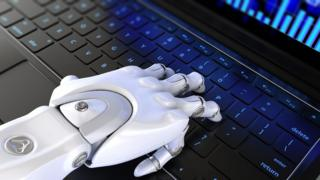 Robot hand on keyboard