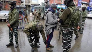 Indian paramilitary Central Reserve Police Force (CRPF) personnel frisks a Kashmiri man during a search operation in Lal Chowk area of Srinagar, the summer capital of Kashmir, India, 19 January 2019.