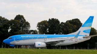 "A Boeing 737-700 aircraft belonging to state-run Aerolineas Argentinas sits on the tarmac of the Buenos Aires"" domestic airport"