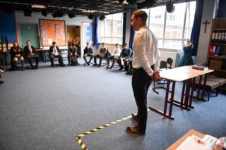 Drama teacher Geoff Nolan gives a socially distanced class to pupils at Holyrood Secondary School in Glasgow for the first time following the easing of coronavirus lockdown measures on August 12, 2020