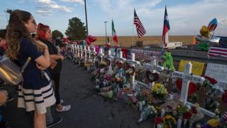 People pay their respects at a makeshift memorial for victims of Walmart shooting, El Paso, Texas, August 5, 2019