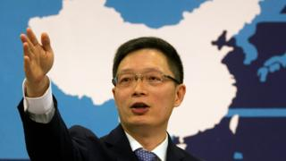 Taiwan Affairs Office spokesman An Fengshan signals for questions from a journalist at a routine press conference in Beijing, China