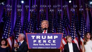 Republican President-elect Donald Trump delivers his acceptance speech during his election night event at the New York Hilton Midtown in the early morning hours of 9 November in New York City.