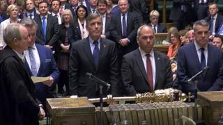 MPs announcing the result of the vote