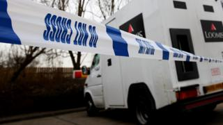 This file photo shows police incident tape around a Loomis security van in London
