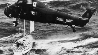 A Royal Navy helicopter rescues the crew of the yacht Camargue after the disastrous Fastnet yacht race