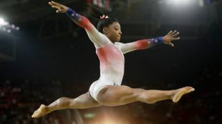 "In this Aug. 17, 2016 file photo, United States"" Simone Biles performs on the balance beam during the gymnastics exhibition gala at the 2016 Summer Olympics in Rio de Janeiro, Brazil."