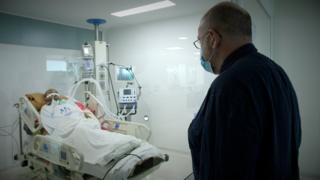 John Sweeney visits a paralysed patient in hospital