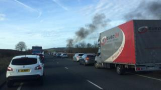 Car fire and traffic on the A55