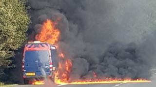 The van on fire on the M4