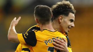 Rayan Ait-Nouri celebrates with team-mate Daniel Podence