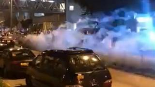 Screen grab from social media shows fireworks fired from moving car in Hong Kong. 31 July 2019