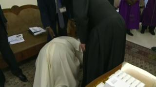 Pope Francis kisses the feet of one of South Sudan's leaders