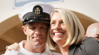 The White House US Navy Seal Edward Gallagher, shown with his wife, smiling
