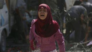 A Syrian girl in the aftermath of an airstrike