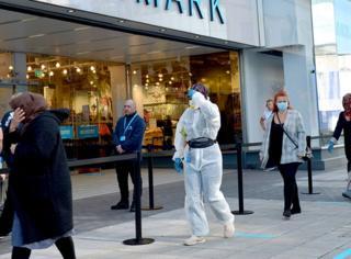 Shoppers queue to enter a Primark store