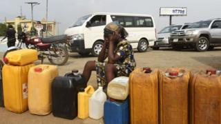 Woman siddon for fuel queue.