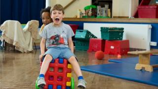 Two children play at Cambridge Kids Club